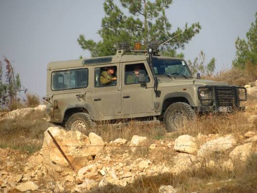 Military Vehicle keeping a watch upon Palestinians plowing their lands, November 2013